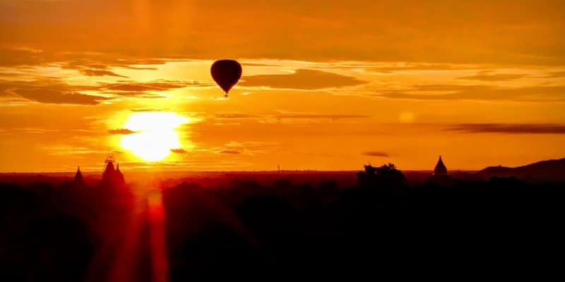 Hot Air Balloon Over Temple at Sunset